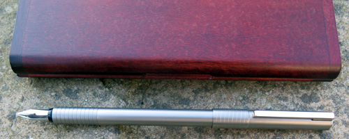 PORSCHE DESIGNS STAINLESS STEEL FOUNTAIN PEN WITH BROAD NIB.